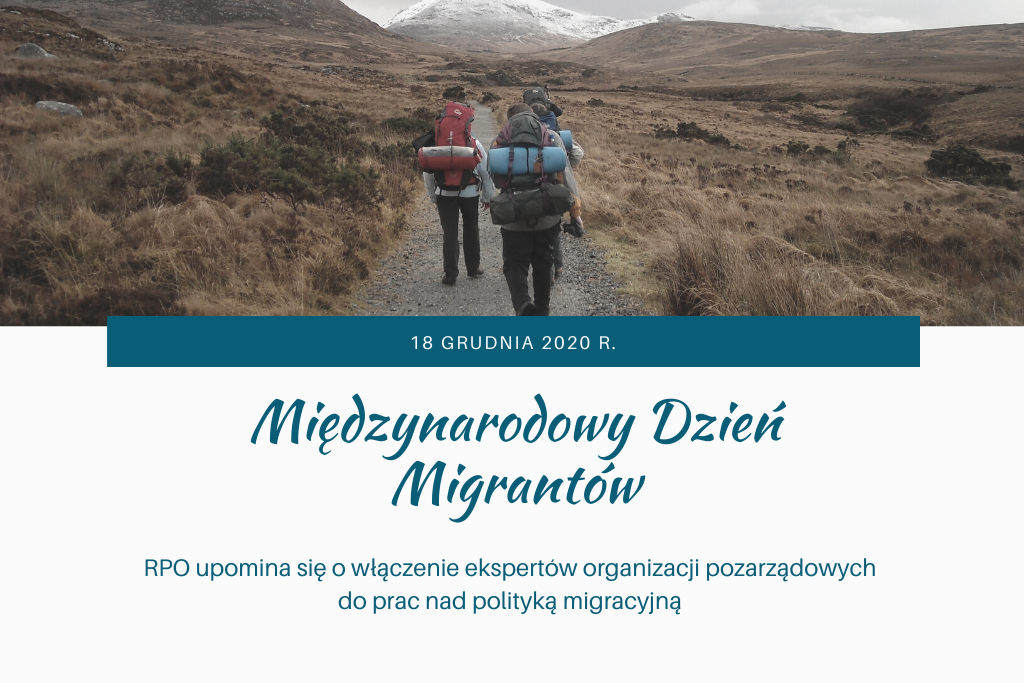 plansza z napisem Międzynarodowy Dzień Migrantów