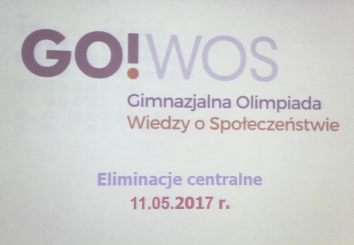 Plansza informacyjna Gimnazjalnej Olimpiady Wiedzy o Społeczeństwie