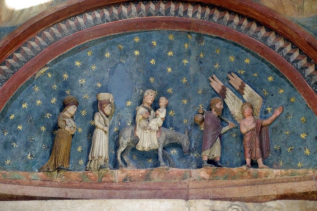 Stara chrzecielnica [rzedstawiająca ucieczkę Świętej Rodziny do Egiptu