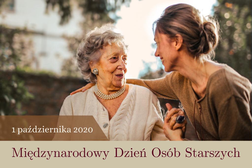 Starsza kobieta rozmawia z młodą, trzymają się za ręce