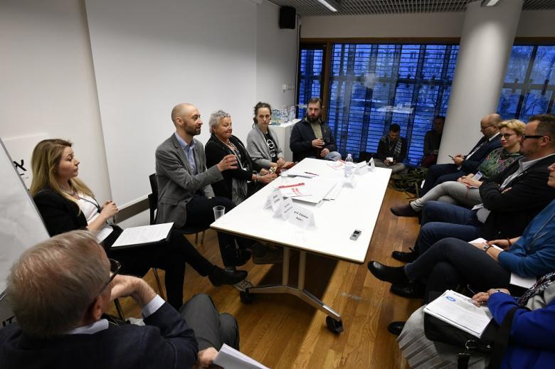 Paneliści i publiczność