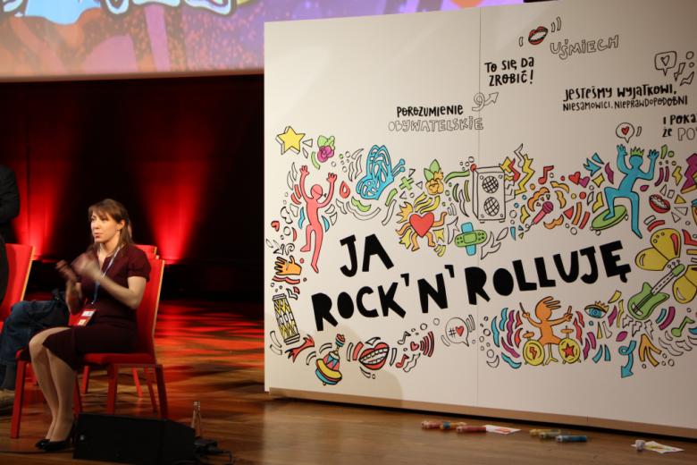 baner z napisem Ja rock'n'rolluję