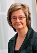 Zdjęcie portretowe kobiety w pomarańczowych okularach