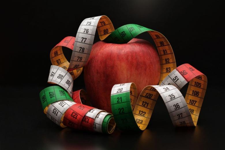 Jabłko z miarką krawiecką